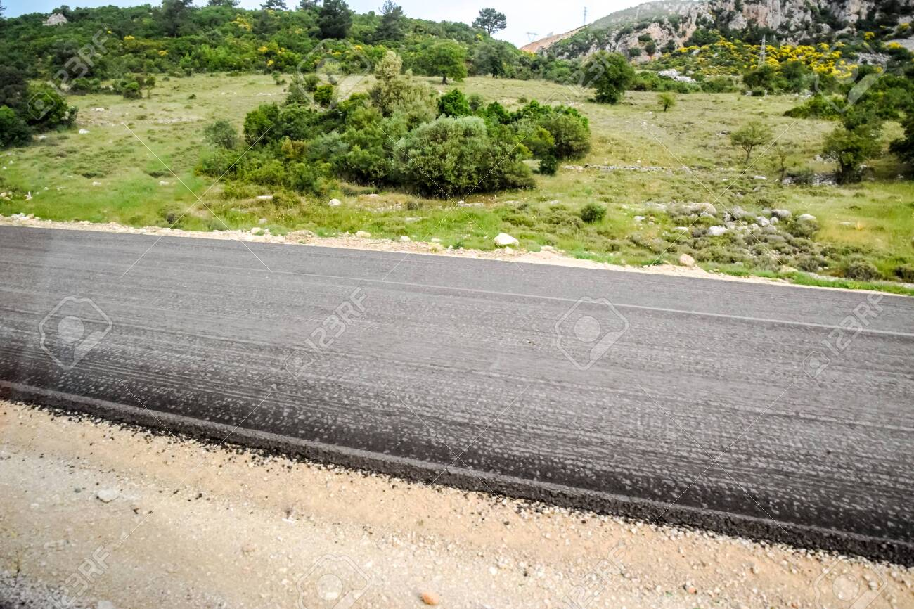 Laying new asphalt on the road. New road and new asphalt. - 126035972