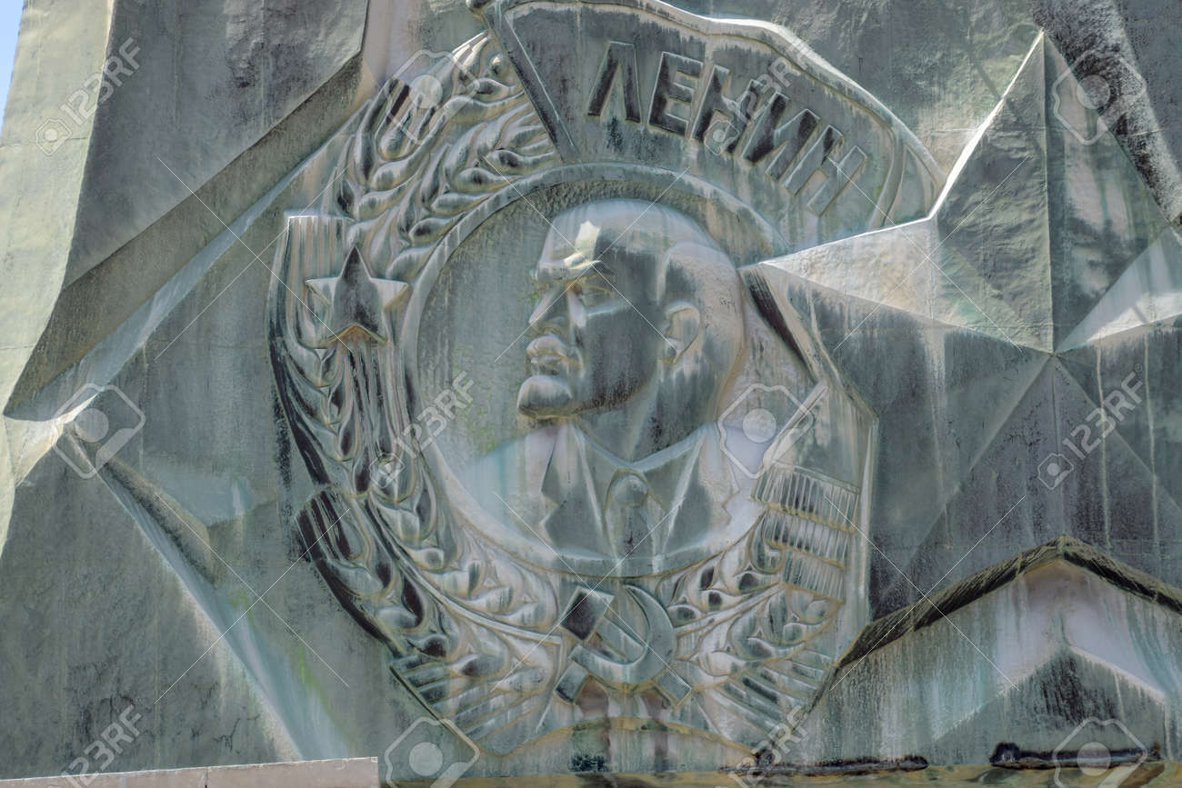 Novorossiysk, Russia - May 20, 2018: Coat of arms with a bas-relief of Lenin on the monument. The leader of the revolution. - 133522193