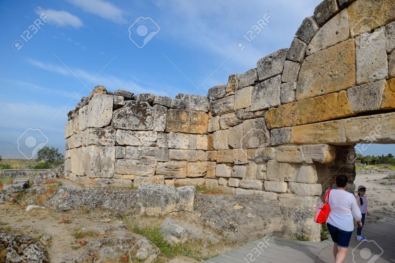 Hierapolis, Turkey - May 22, 2019: The walls of the ancient ruins of limestone blocks. Ruins of the city of Hierapolis, Turkey. - 133523029
