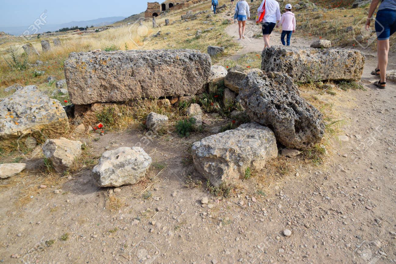 Pamukkale, Hierapolis, Turkey - May 22, 2019: Tour groups on the ruins of Hierapolis. Tourists are shown the ruins of the ancient city. - 133523209