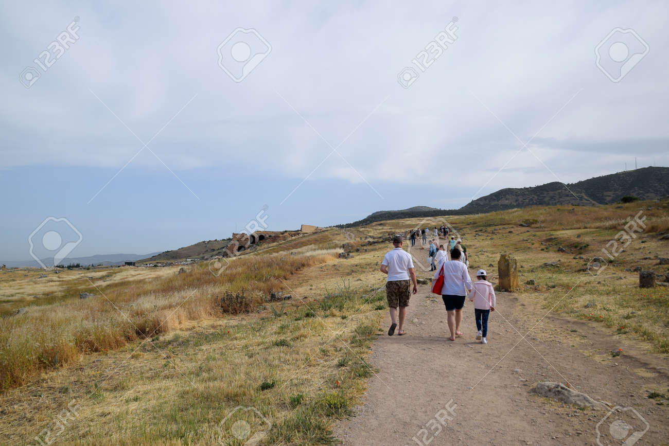 Pamukkale, Hierapolis, Turkey - May 22, 2019: Tour groups on the ruins of Hierapolis. Tourists are shown the ruins of the ancient city. - 133523210