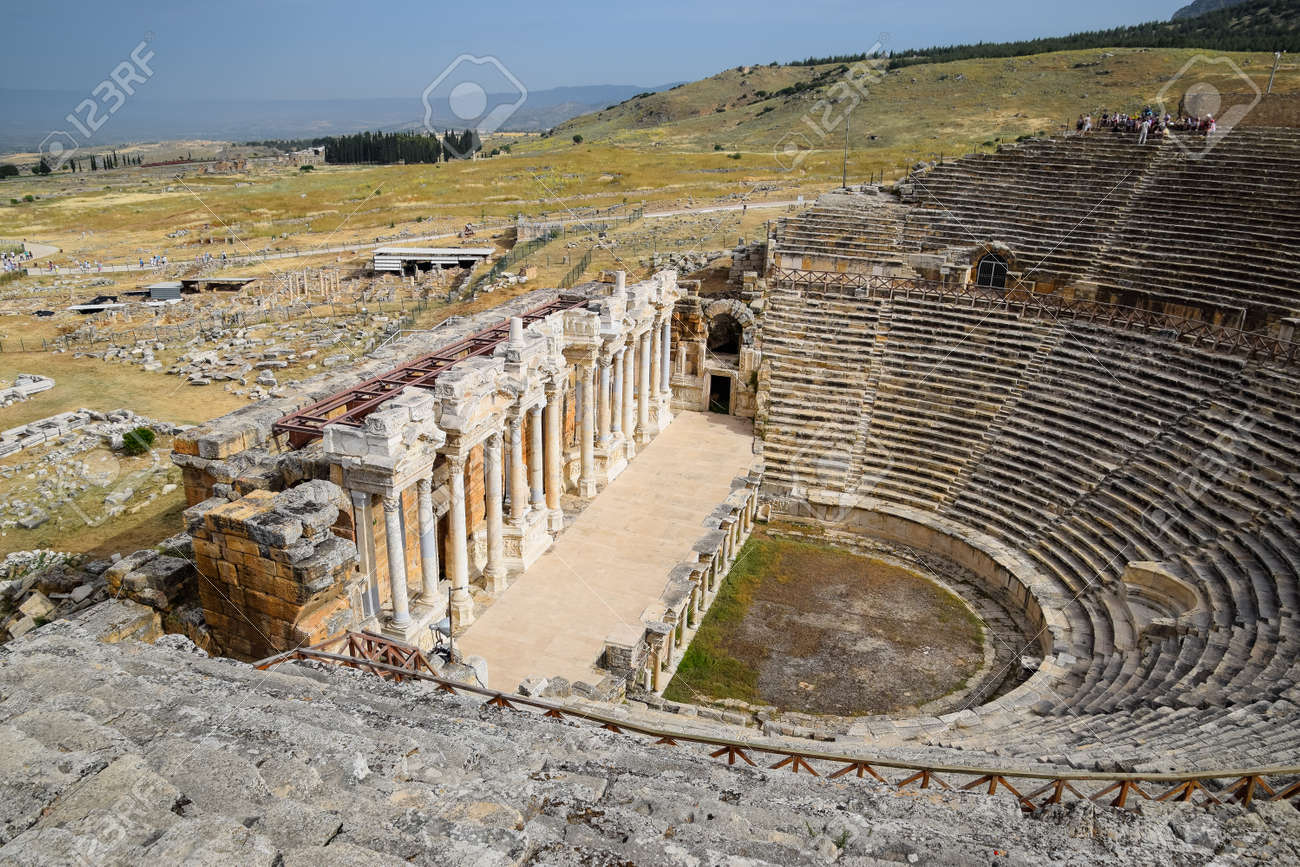 Pamukkale, Hierapolis, Turkey - May 22, 2019: Ancient antique amphitheater in the city of Hierapolis in Turkey. Steps and antique statues with columns in the amphitheater - 133523219