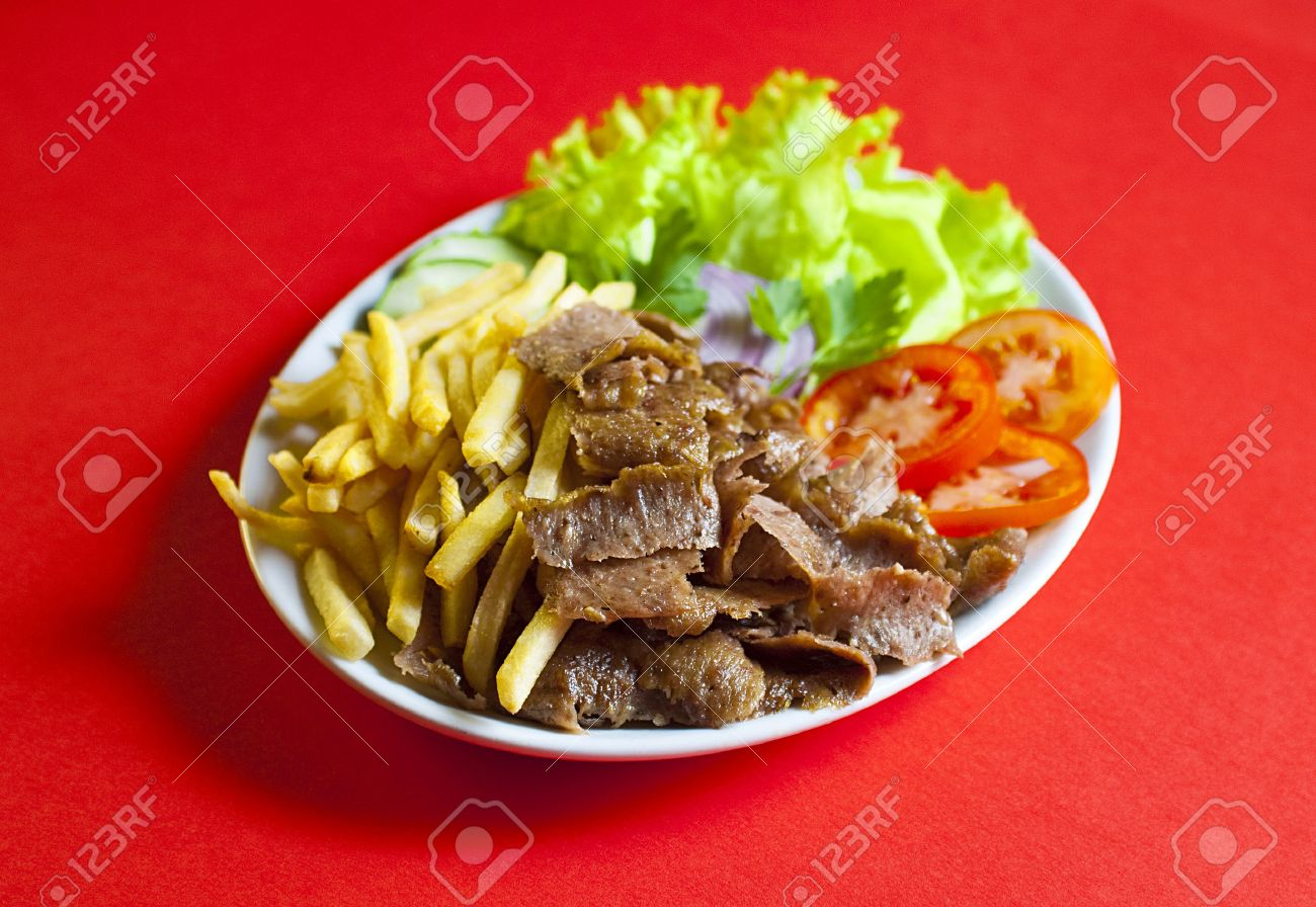 Traditional Turkish Doner Kebab In Bread Served On White Plate Stock Photo Picture And Royalty Free Image Image 37615976