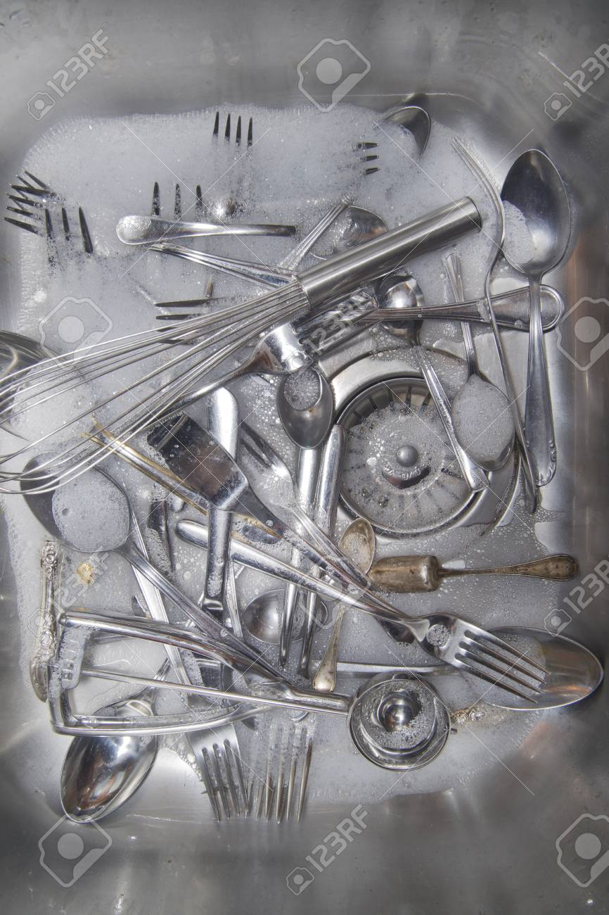 Sink with cutlery ready to be washed Stock Photo - 25202941