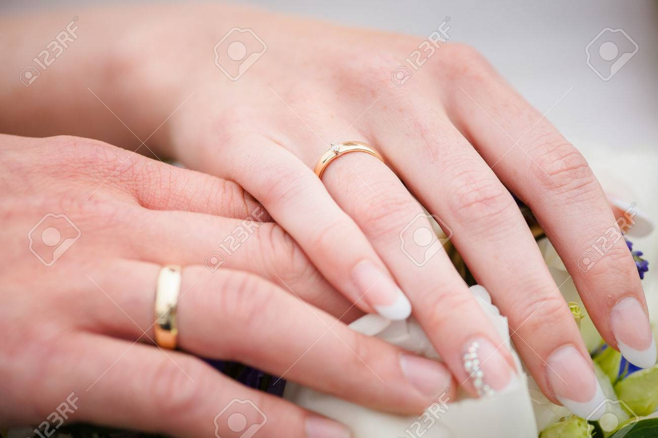 A Newly Weding Couple Showing Off Their Wedding Rings. Stock Photo ...