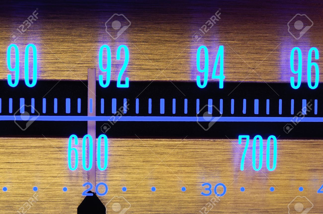 70�s Old radio dial close-up with glowing scale numbers Stock Photo - 10786739