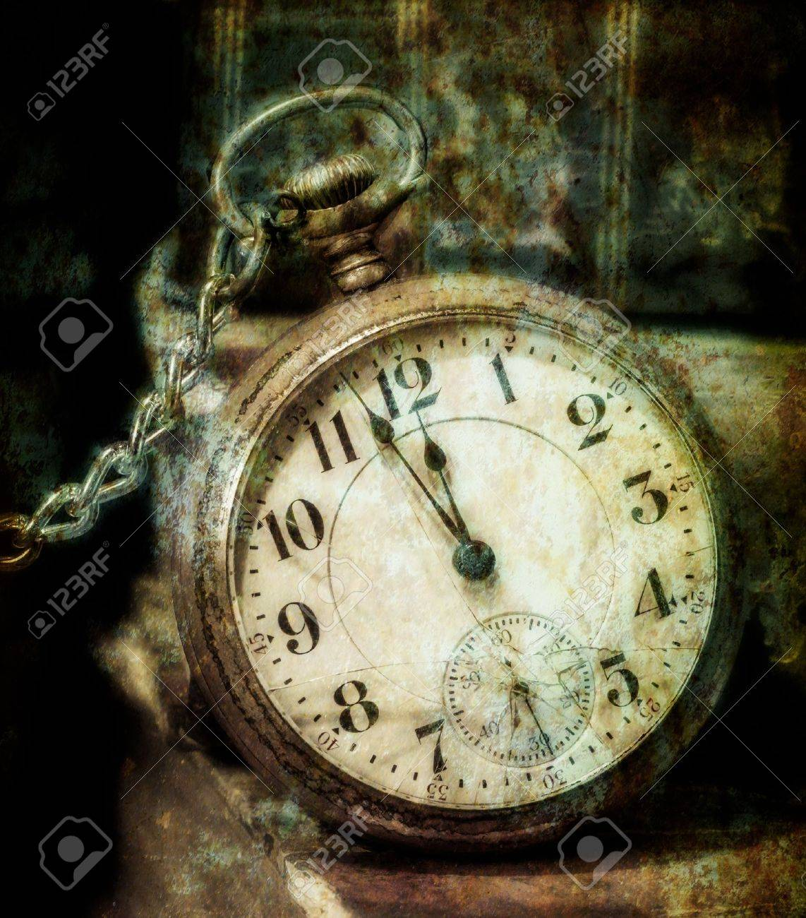 Antique pocket clock showing a few minutes to midnight grungy style  Concept of time,the past Stock Photo - 16418909