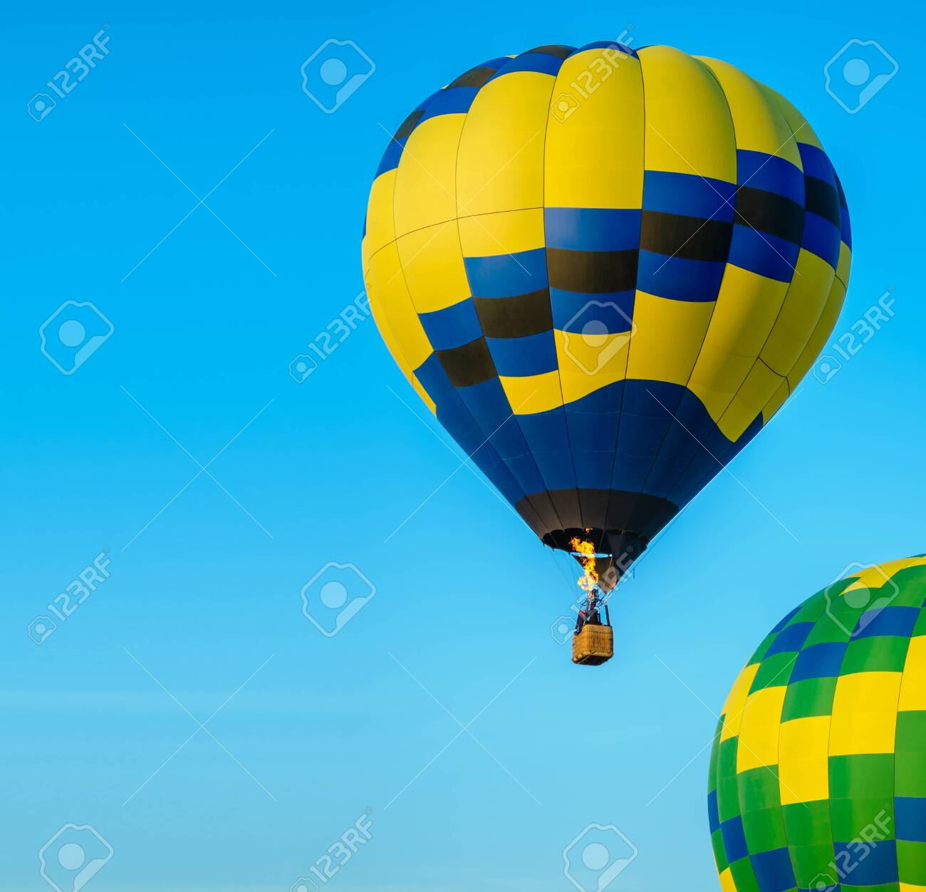 Colorful hot air balloon taking off with blue sky and copy space - 130888107