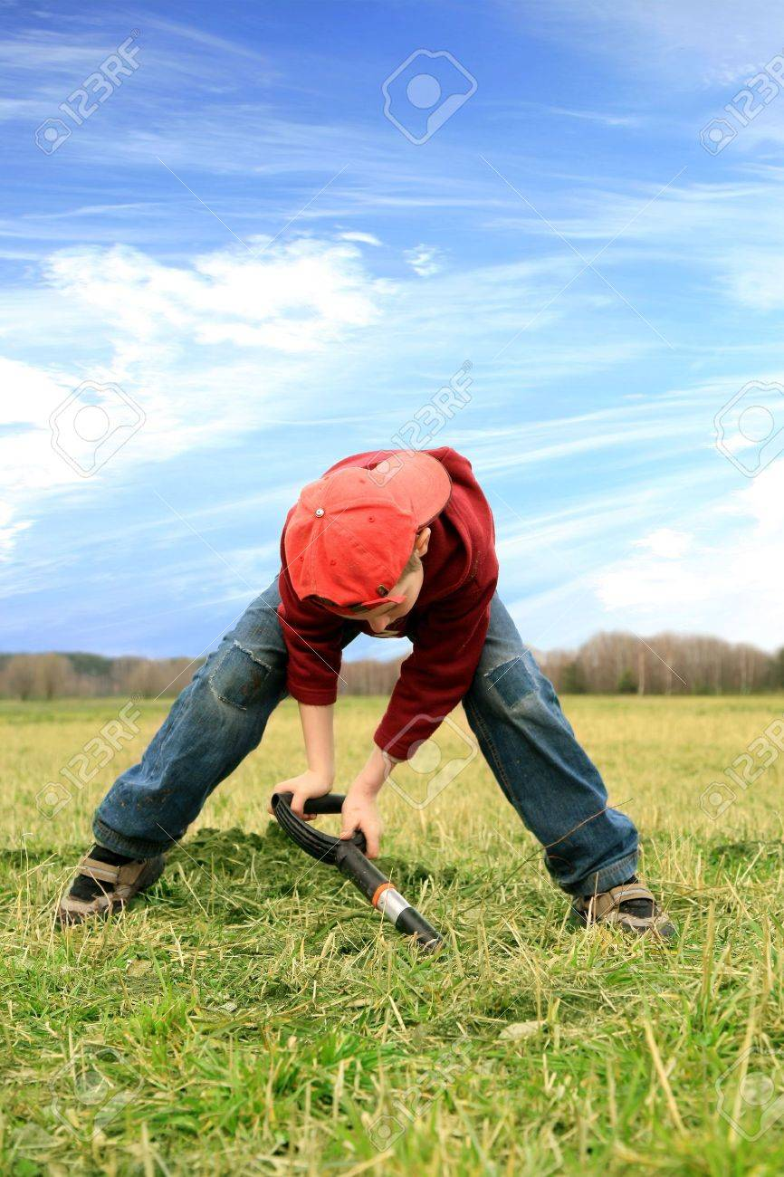 Little boy digging on the meadow. Reclamation of wasteland, planting new trees Stock Photo - 4568867