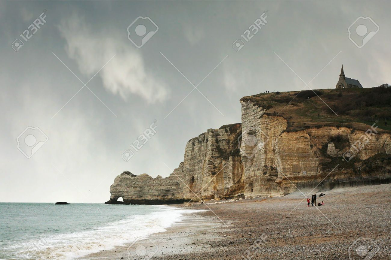 Famous cliffs in Etretat which Impressionists painted, including Monet. Small tourist town in Normandie, France Stock Photo - 4692160