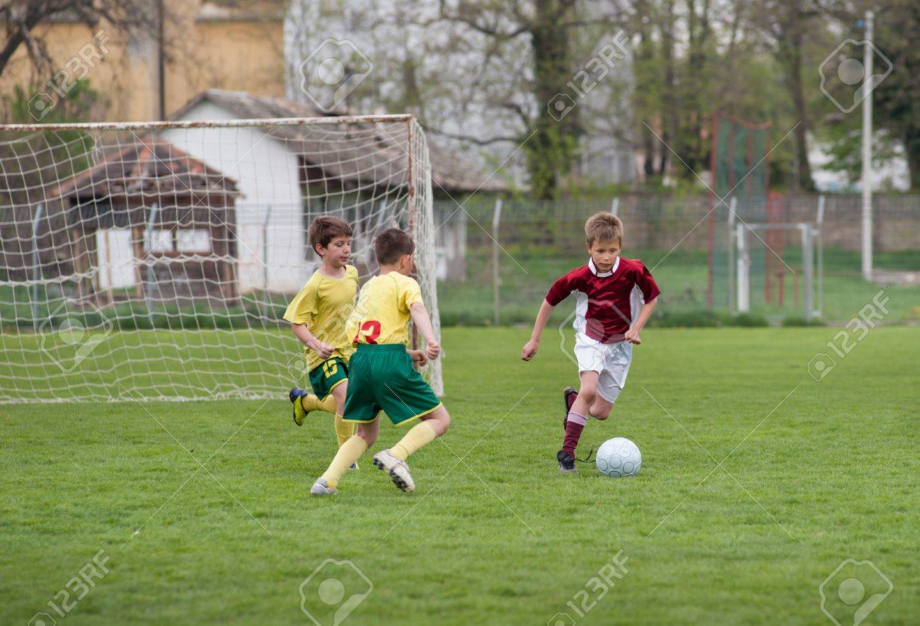 boys kicking ball on the sports field Stock Photo - 17289338