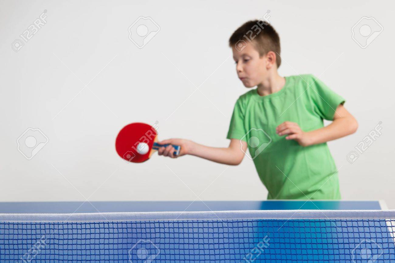 Little Boy Playing Table Tennis Stock Photo, Picture And Royalty