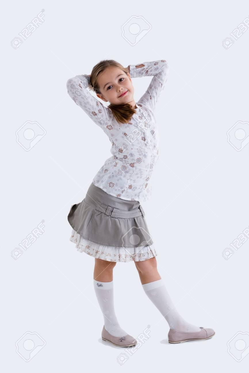 Cute girl in skirt posing Stock Photo - 17640777