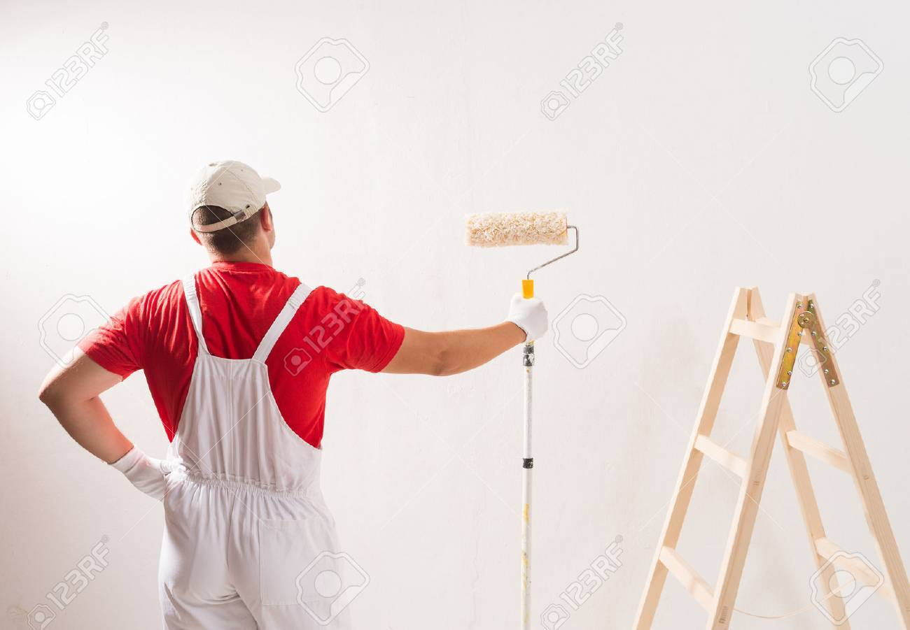 Young Man On Painting Wall With Roller - 44220074