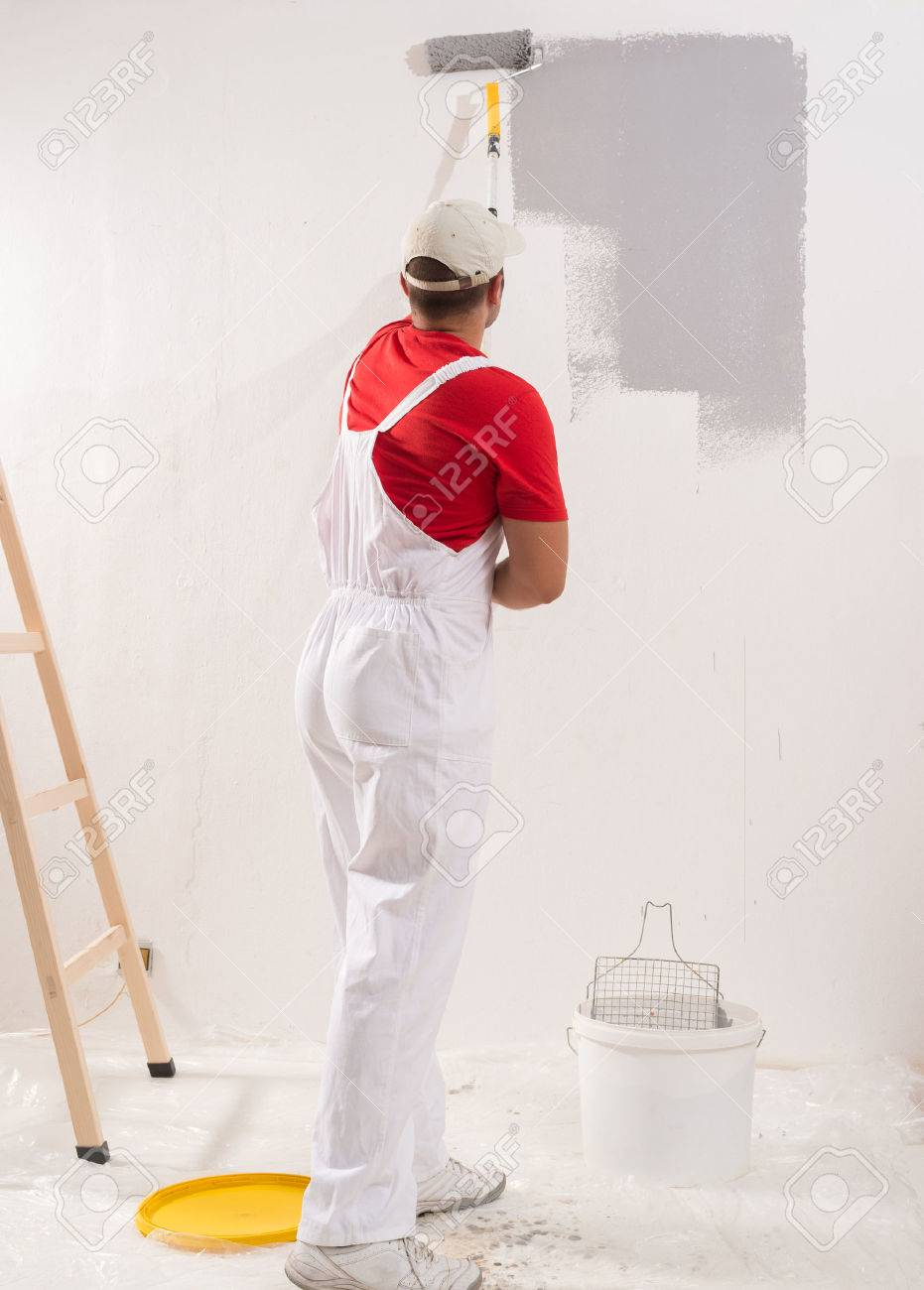 Young Man On Painting Wall With Roller - 44220102