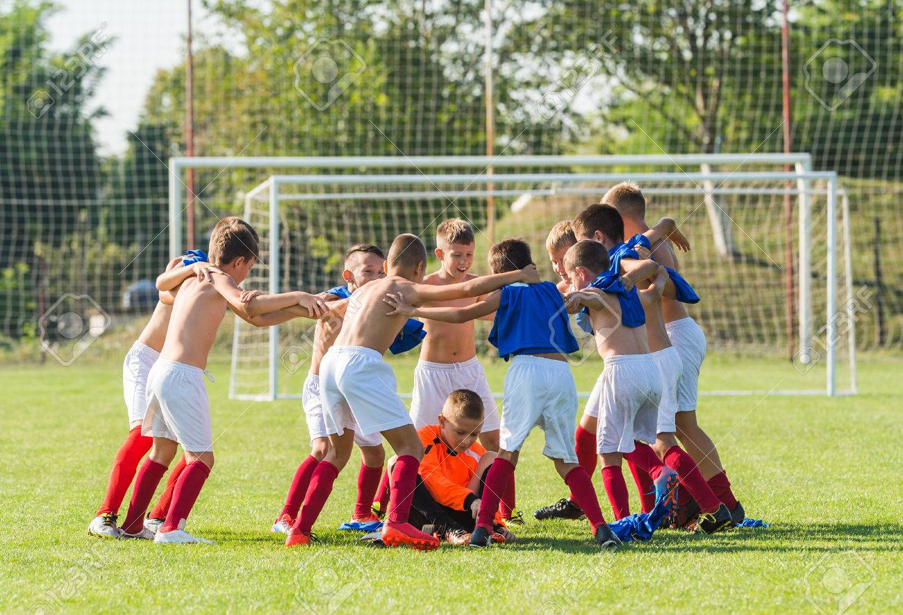 89cd2395ffd kids soccer team in group huddle Stock Photo - 64216988