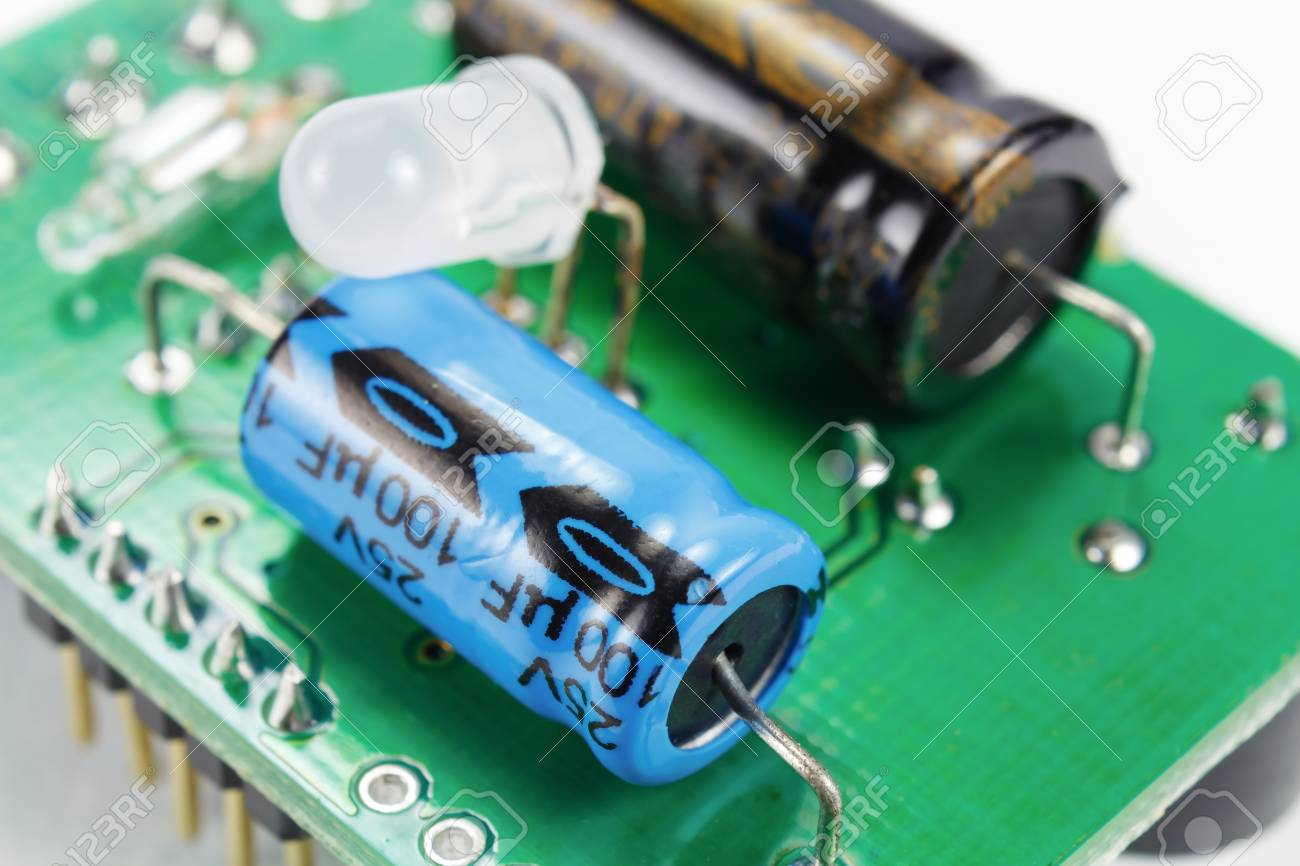 Electrolytic Capacitors And Led Diode On A Printed Circuit Board Of Transistors Other Components Stock Photo 100181106