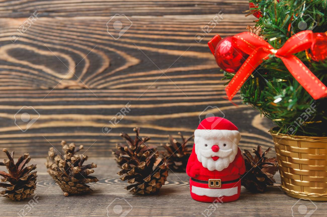 christmas happy new year fir tree with santa claus toy background on wooden backdrop merry