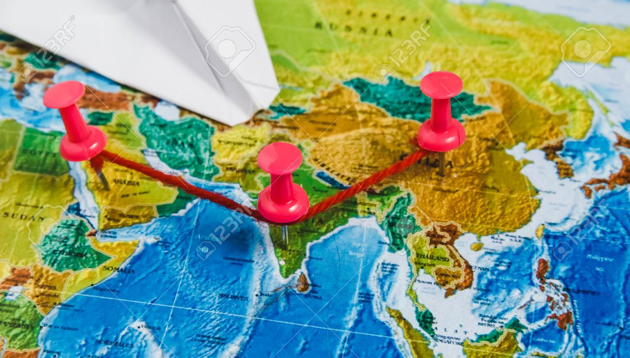 Travel destination points on world map indicated with colorful stock photo travel destination points on world map indicated with colorful thumbtacks red rope and shallow depth of field gumiabroncs Images