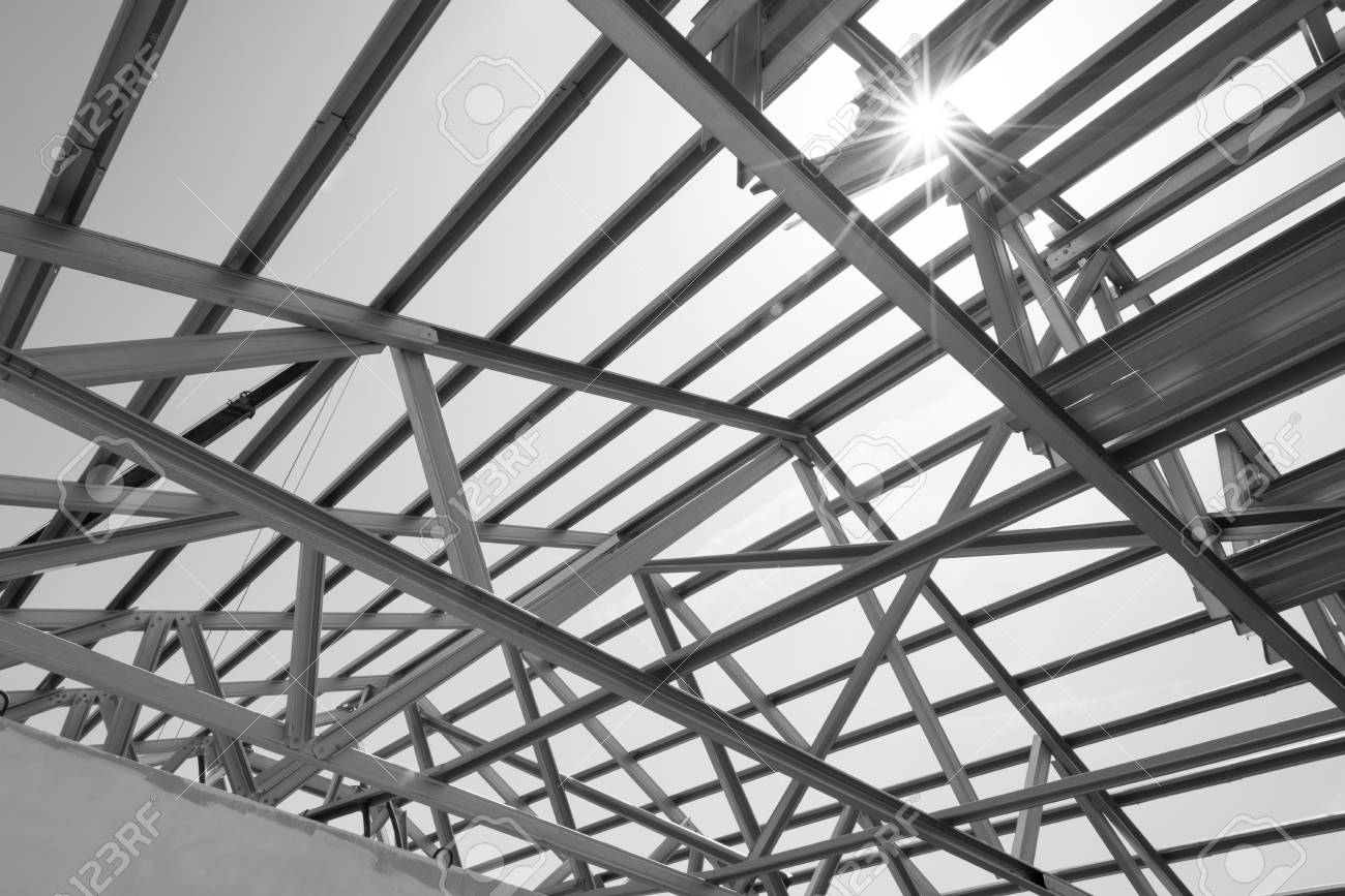 Black and white photostructure of steel roof frame for building construction the advantage