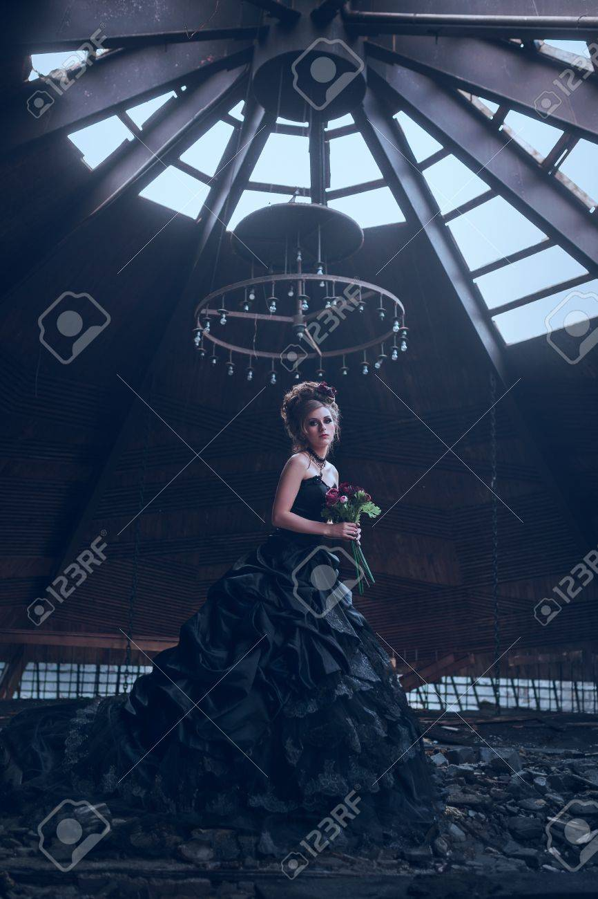 Mysterious woman dressed in gothic dress posing in ruined building Stock  Photo - 25110301 cb5481148