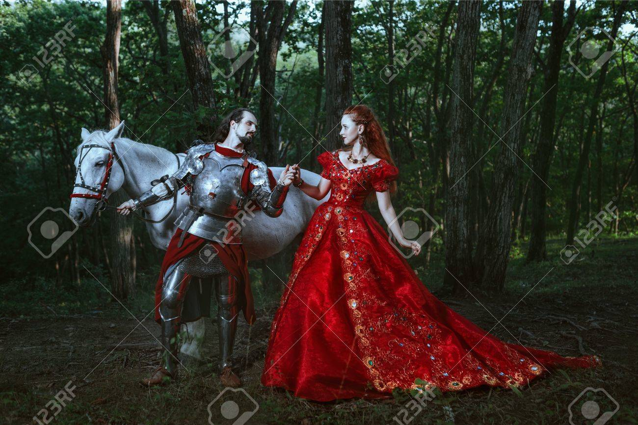 Medieval knight with his beloved lady in red dress - 52186052