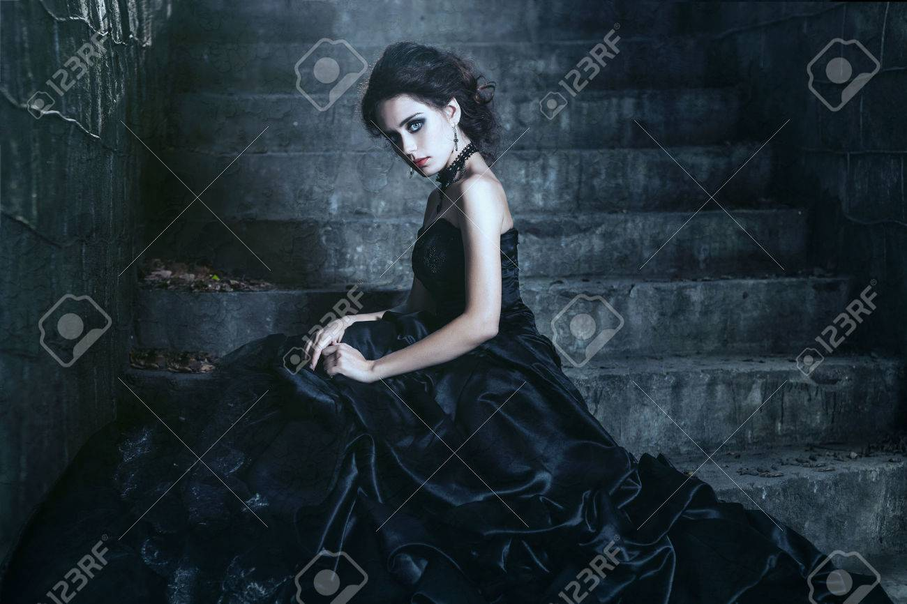Shoot of sad brunette over the ancient building background Stock Photo c4cdd7c4f