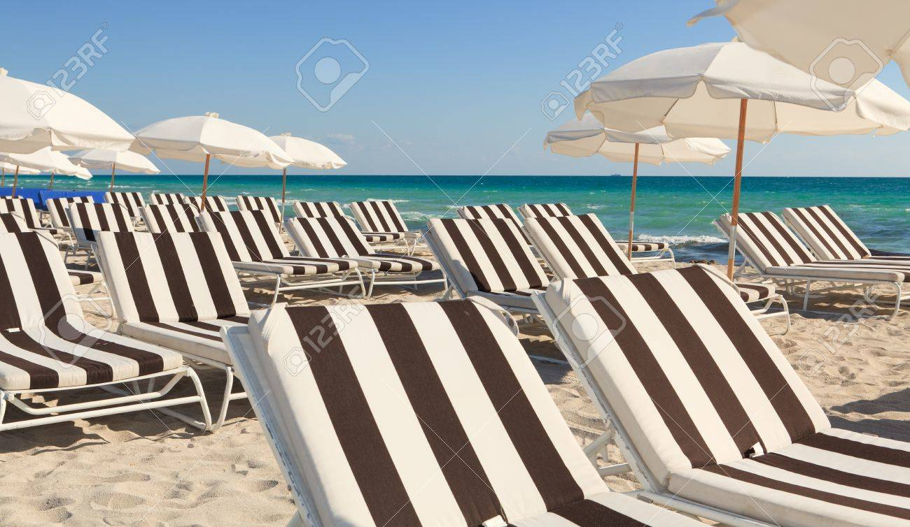 Colorful Umbrellas and Lounge Chairs in South Beach Miami Stock Photo - 8930167