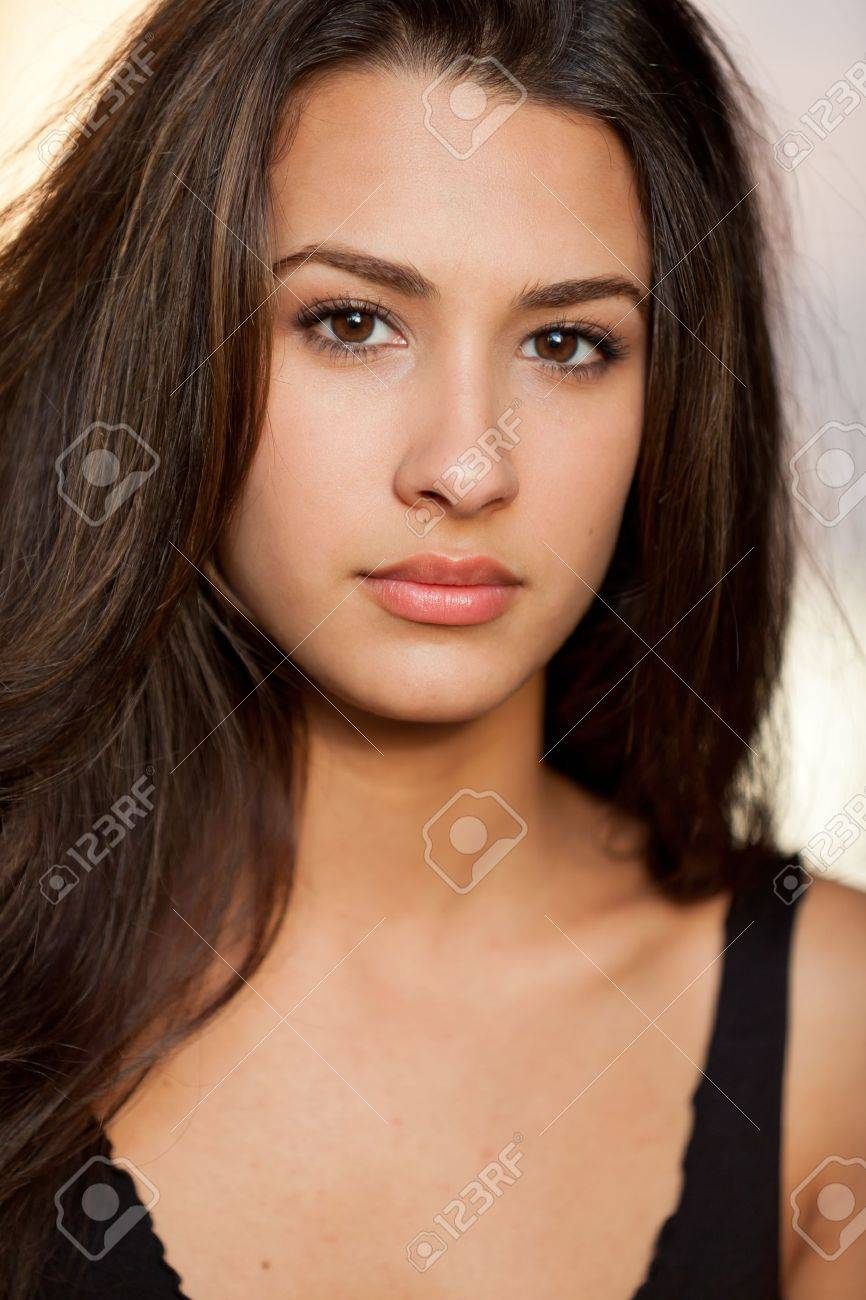 Beautiful young multicultural woman in an outdoor setting Stock Photo - 10699617