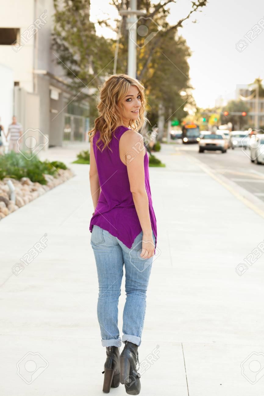 Beautiful young woman outdoors Stock Photo - 12566540