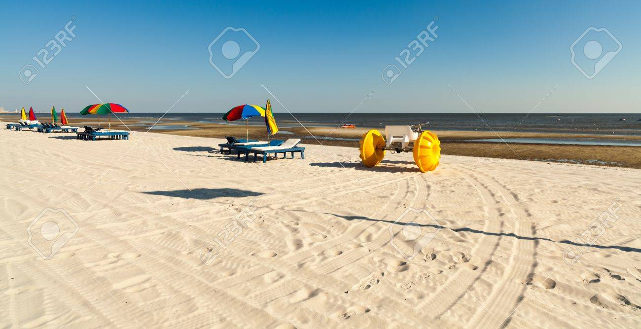 Gulf Coast Beach In Biloxi Mississippi With Water Tricycle And