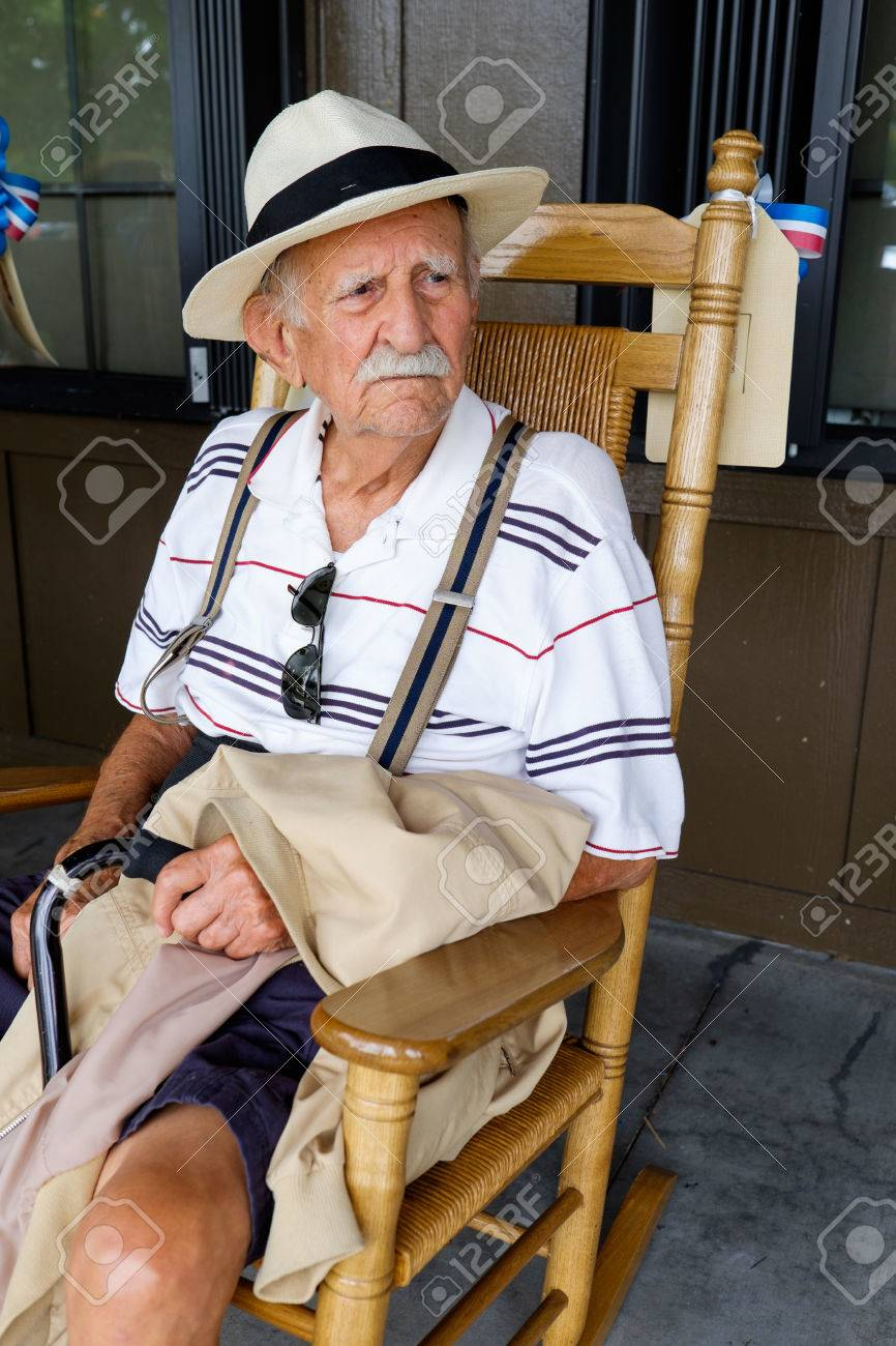 Elderly Eighty Plus Year Old Man Sitting On A Rocking Chair Stock