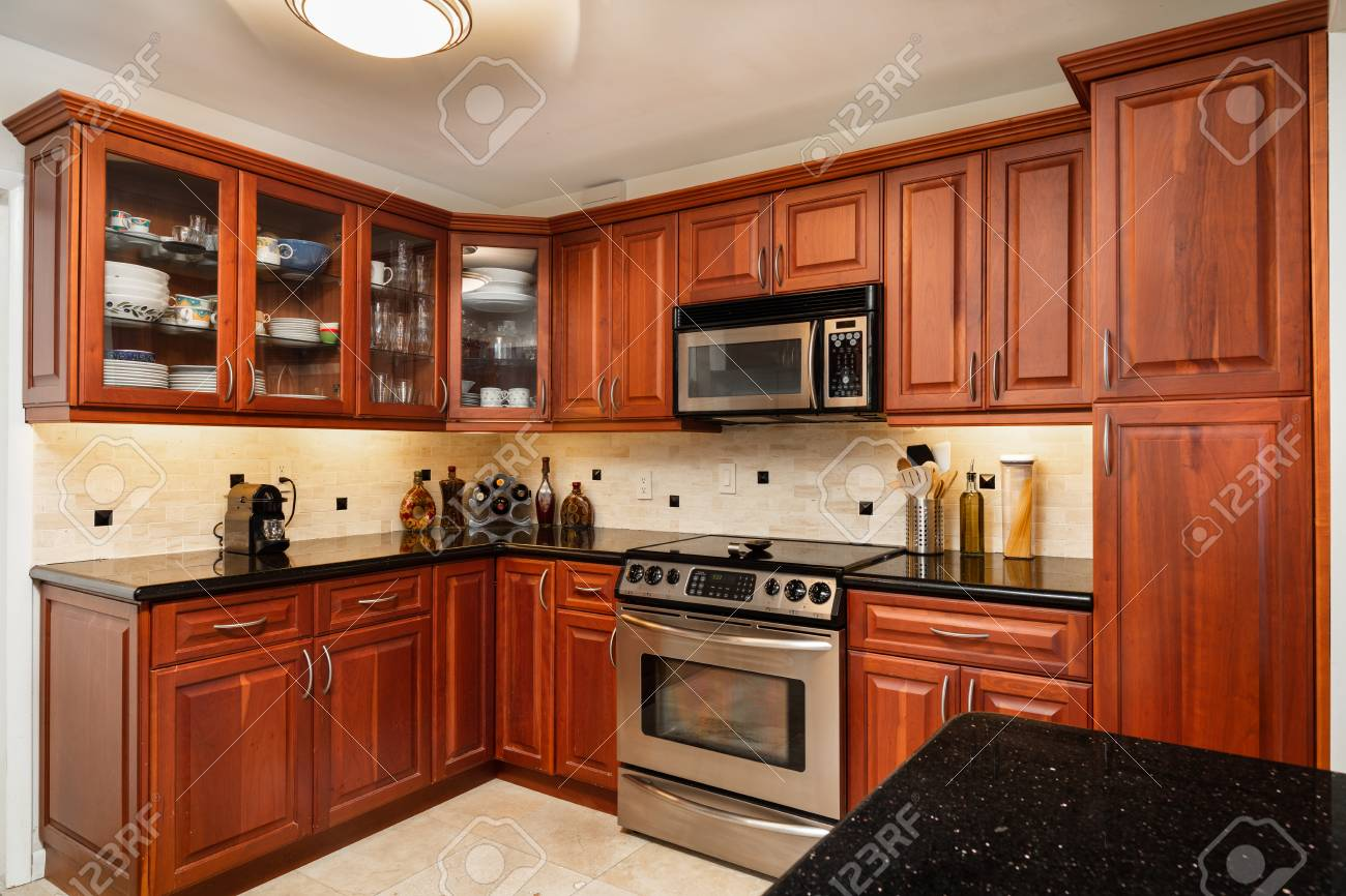 Traditional Cheery Wood Cabinet Home Kitchen With A Black Granite Stock Photo Picture And Royalty Free Image Image 115200515