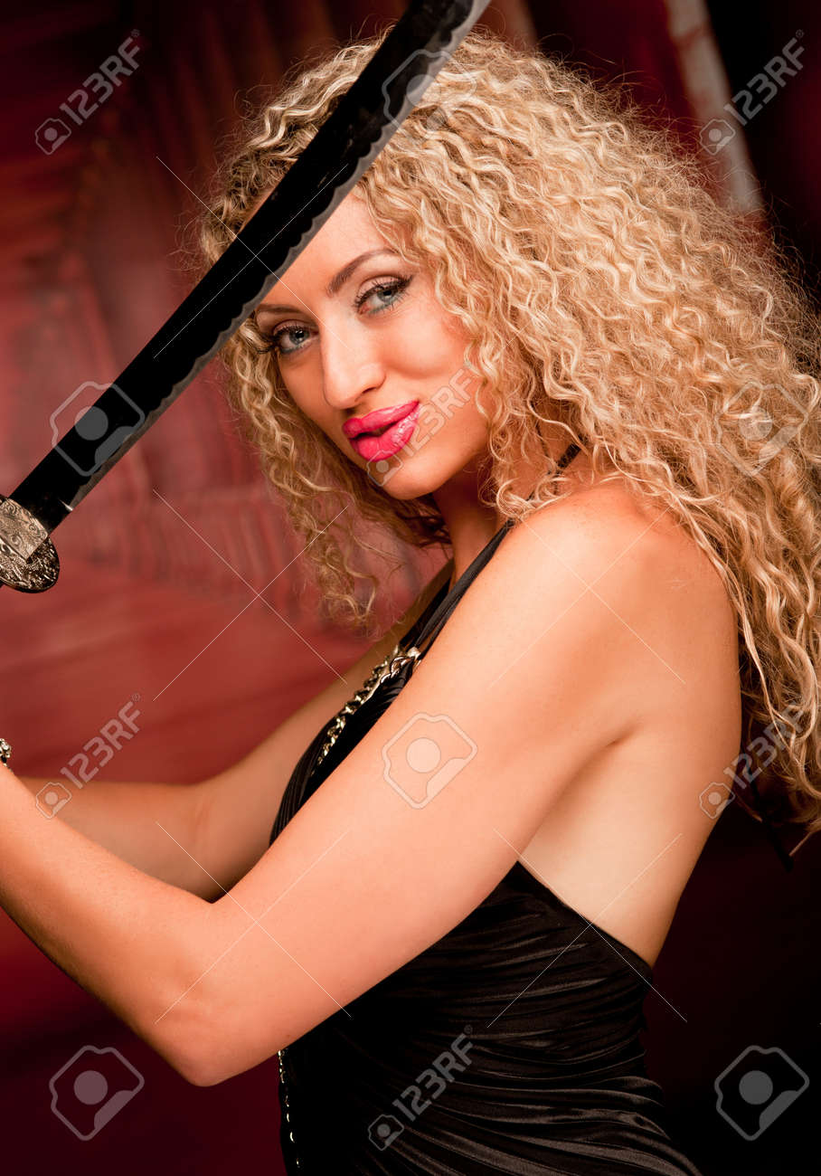 Young woman with a japanese sword Stock Photo - 9908478