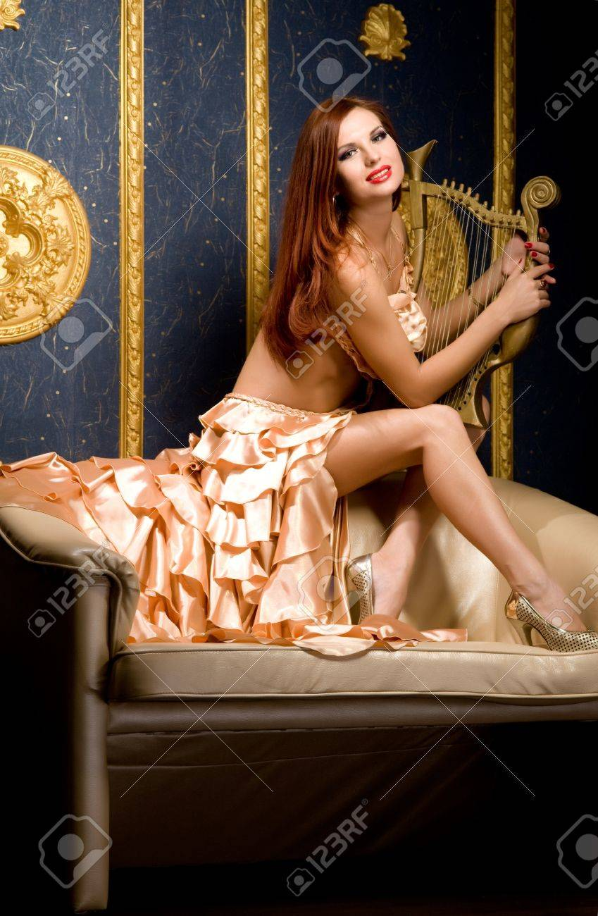 IMAGE(http://previews.123rf.com/images/fotoluxstudio/fotoluxstudio1203/fotoluxstudio120300154/12886814-woman-holding-a-harp-in-a-beautiful-dress-against-a-blue-wall-Stock-Photo.jpg)