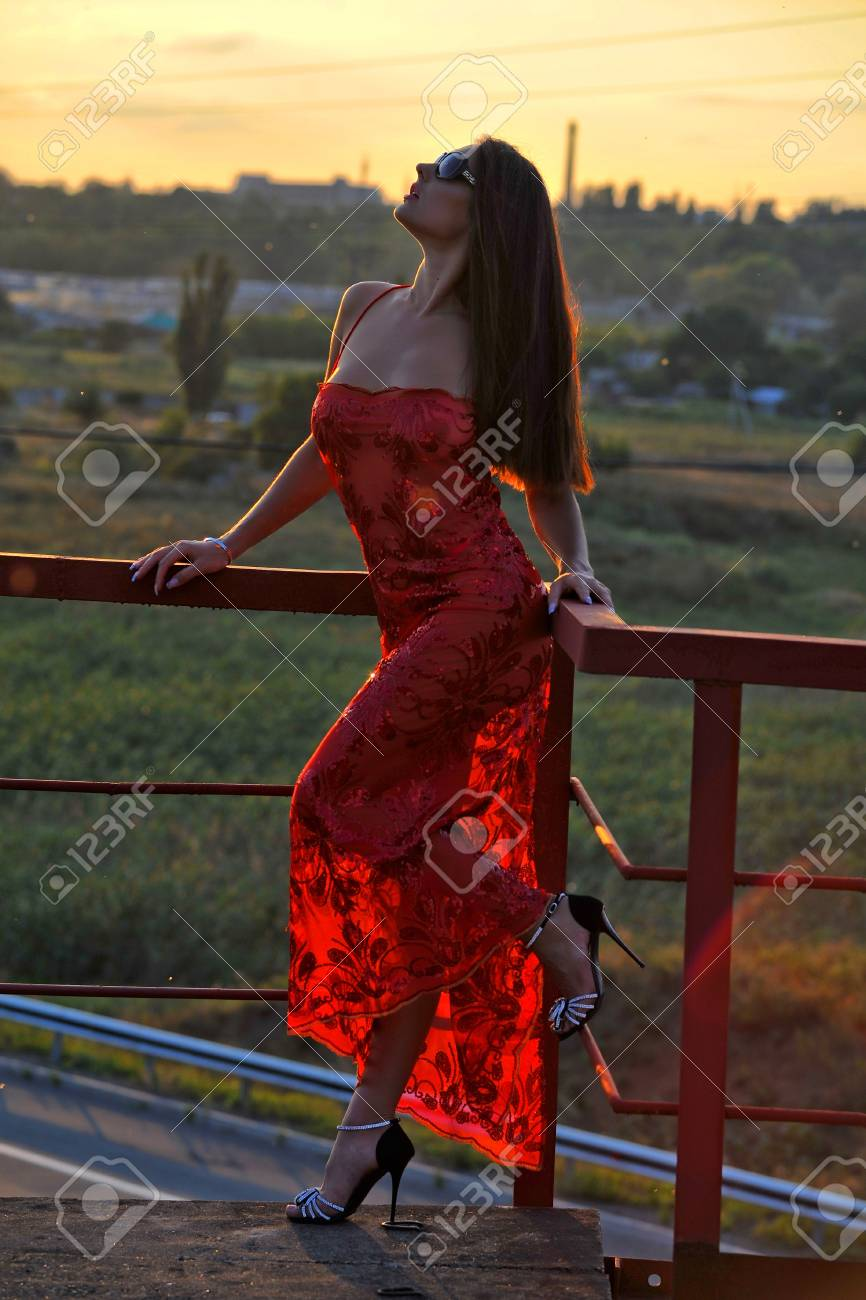 girl in a red dress and glasses on the street Stock Photo - 16114625