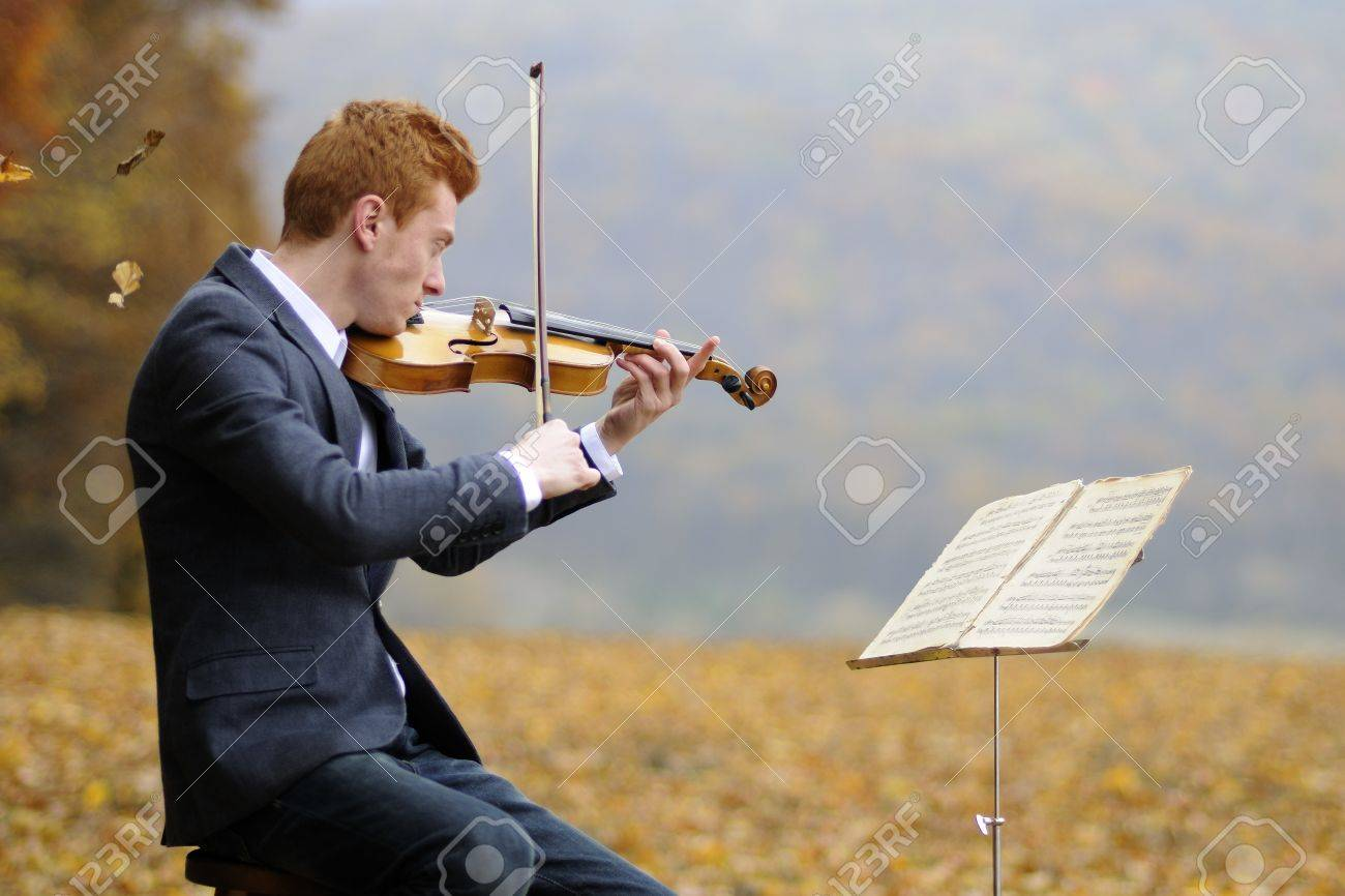 young man playing a violin Stock Photo - 11277855
