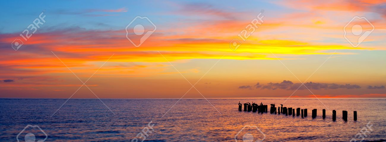 Sunset Or Sunrise Landscape Panorama Of Beautiful Nature Beach With Colorful Red Orange