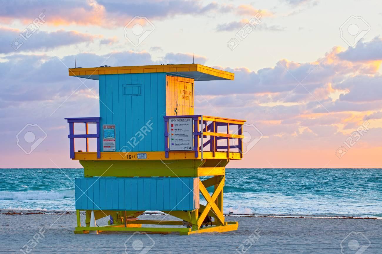 Sunrise in miami beach florida with a colorful lifeguard house