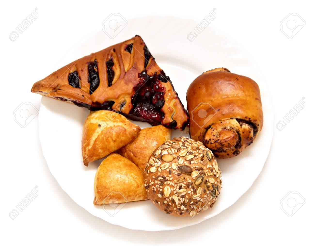 Assorted pastries and pies with filling baking on a white plate Stock Photo - 25200542  sc 1 st  123RF.com & Assorted Pastries And Pies With Filling Baking On A White Plate ...