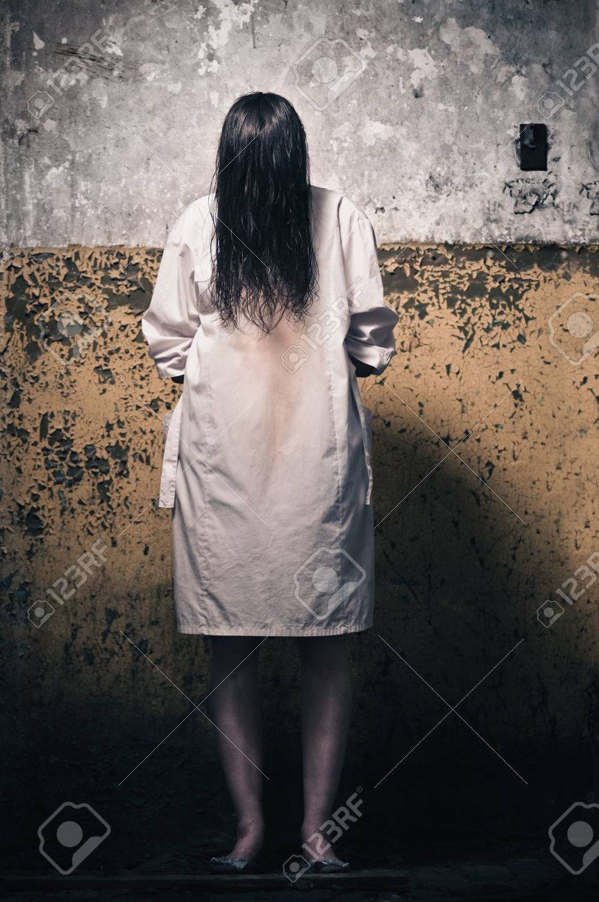 Horror Scene With Girl In A White Coat Stock Photo, Picture And ...