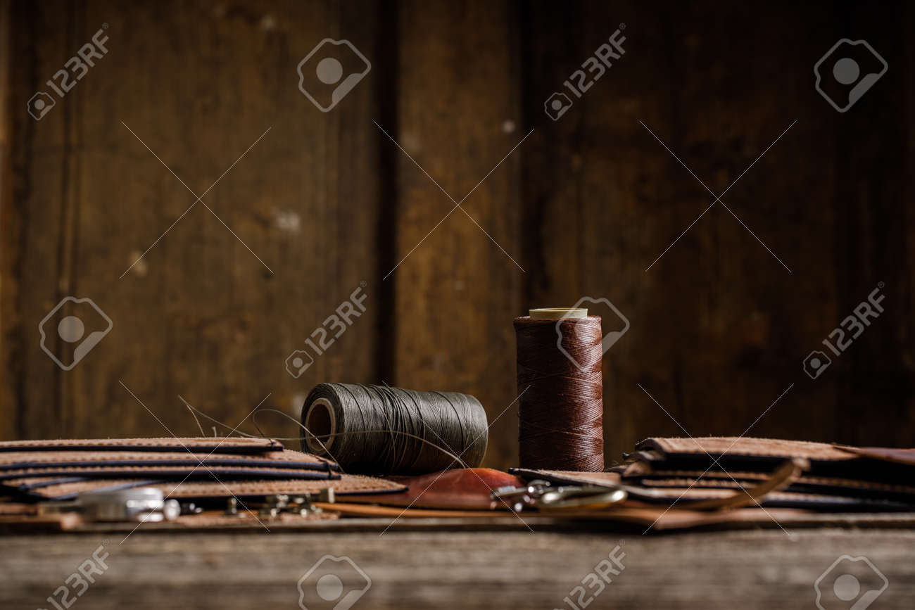 Leather craft tools on old wood table. Leather craft workshop. - 157470629