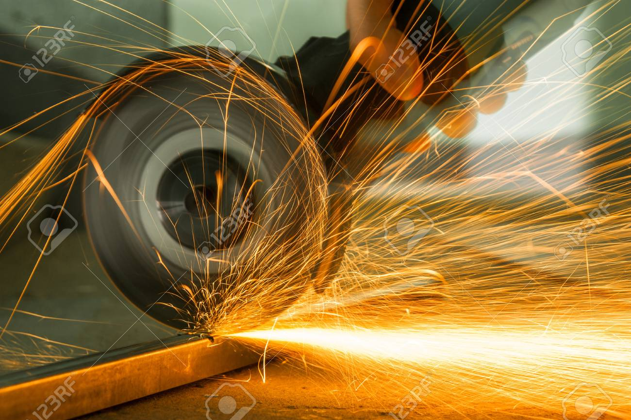 Red hot sparks at grinding steel material Stock Photo - 18992521