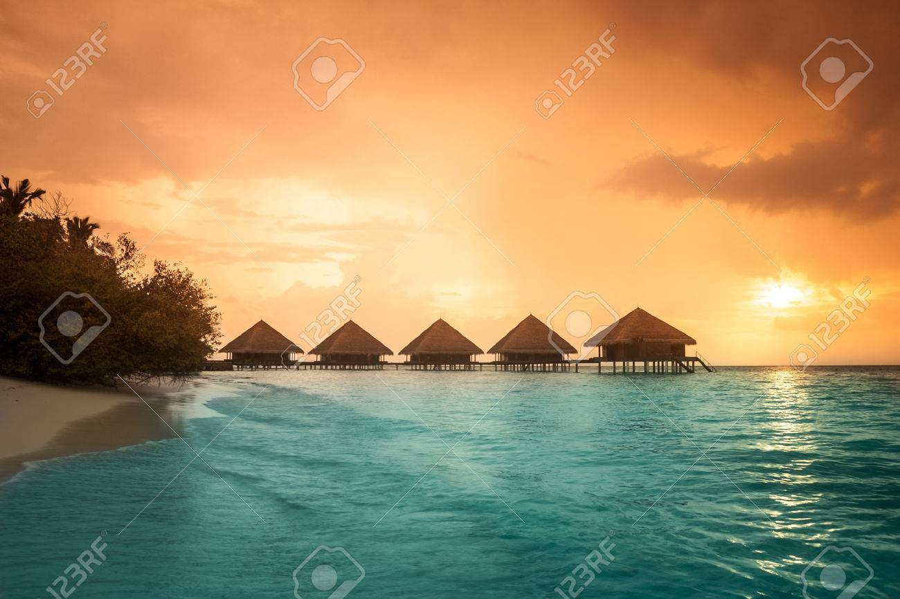 Over water bungalows with steps into amazing green lagoon Stock Photo - 23012746