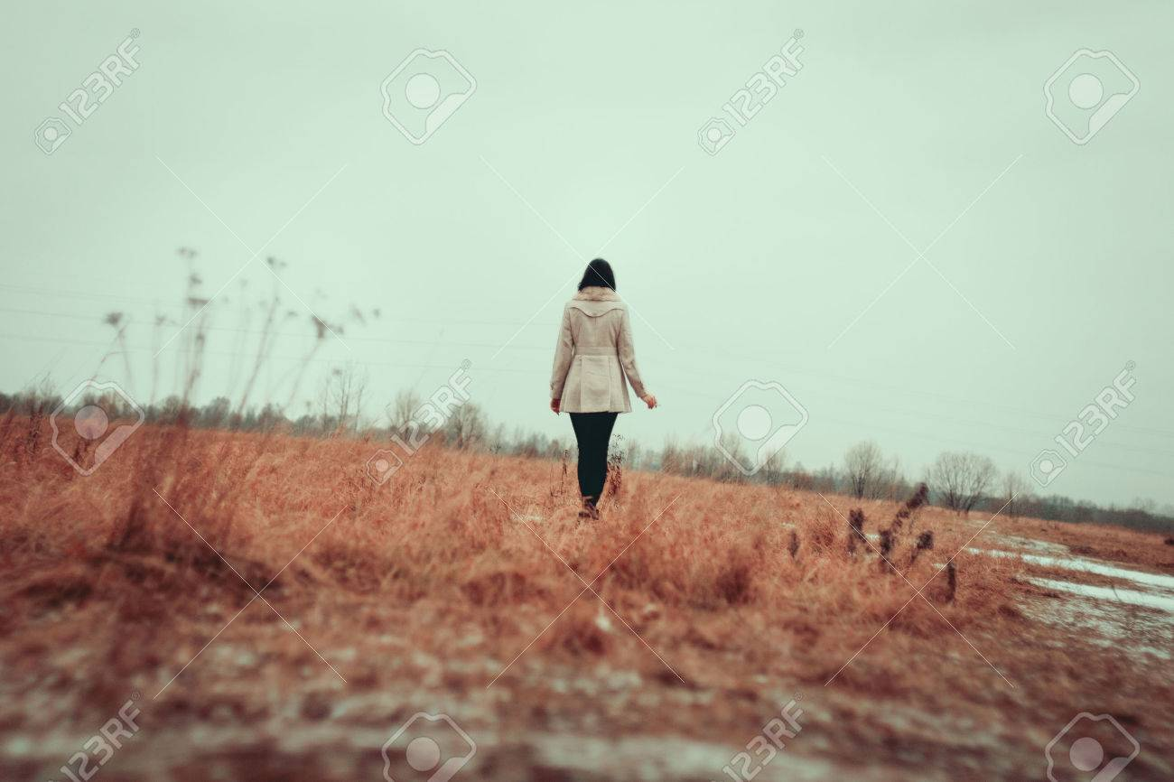 Young girl walking on grass field Stock Photo - 25103016