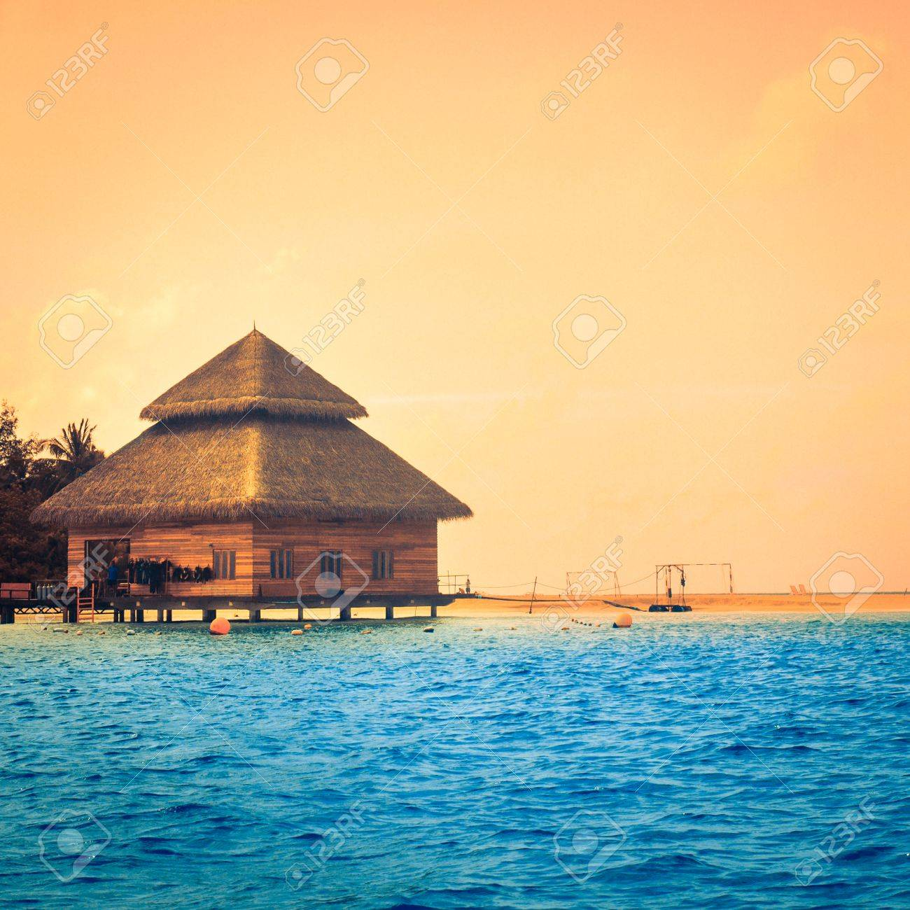 Over water bungalows with steps into amazing green lagoon Stock Photo - 26452064