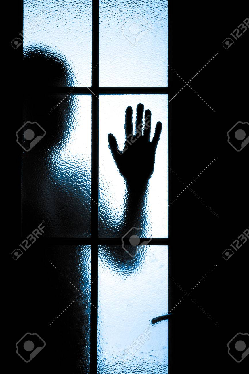 Scared boy behind glass door showing one hand Stock Photo - 27921646