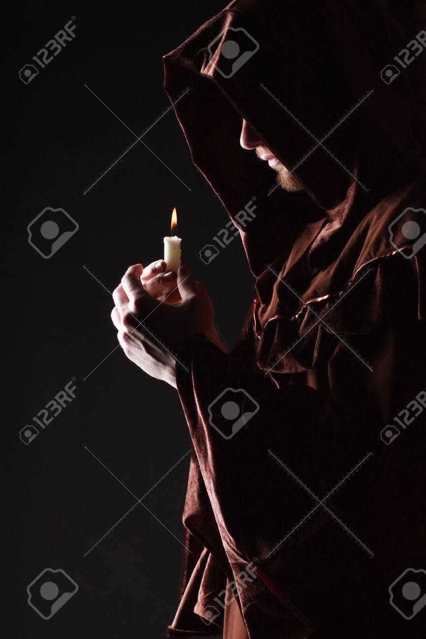 mysterious Catholic monk  studio shot Stock Photo - 27936517