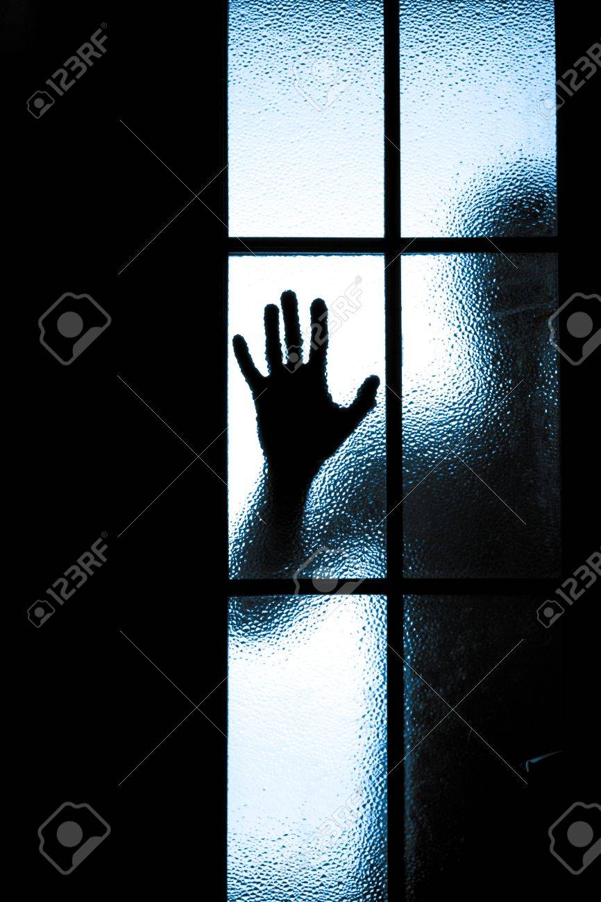 diffused silhouette of people through frosted glass Stock Photo - 29794850