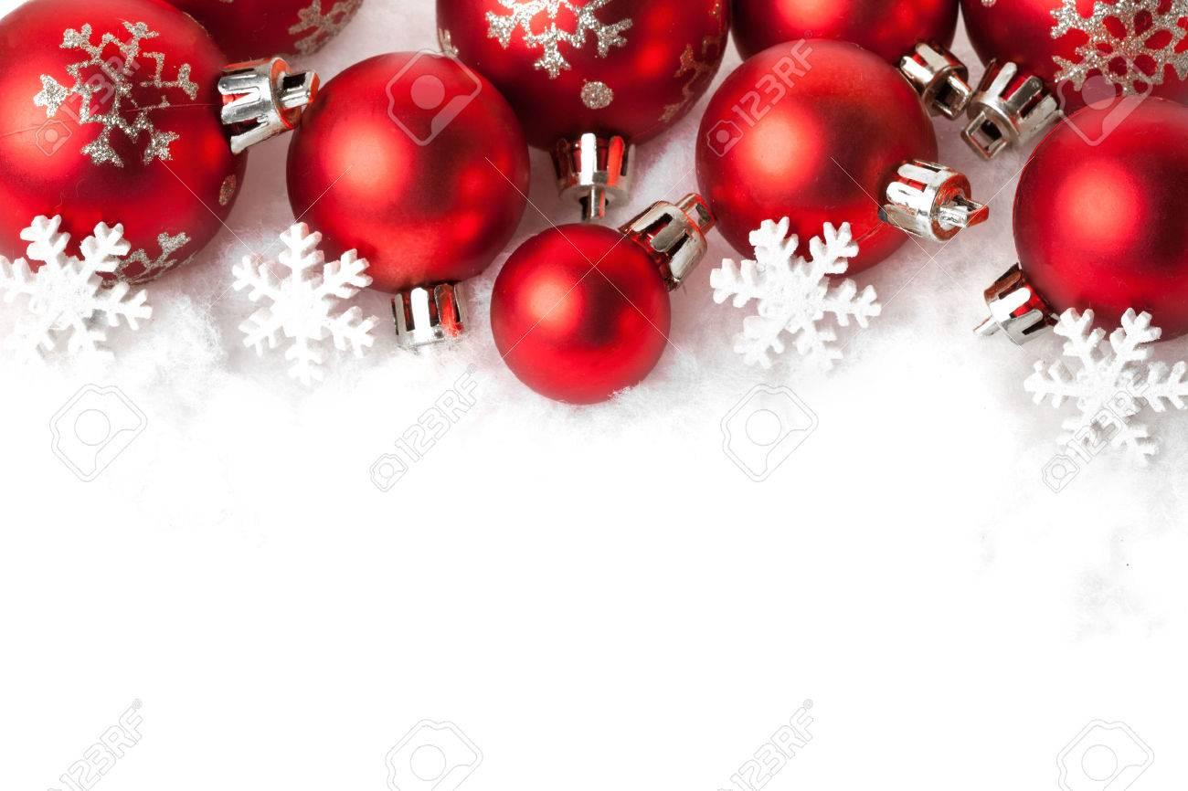 red christmas balls in the snow on white. studio shot Stock Photo - 33236242